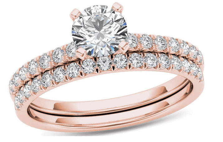 Zales 1 carat diamond and rose gold engagement ring and diamond ladies band